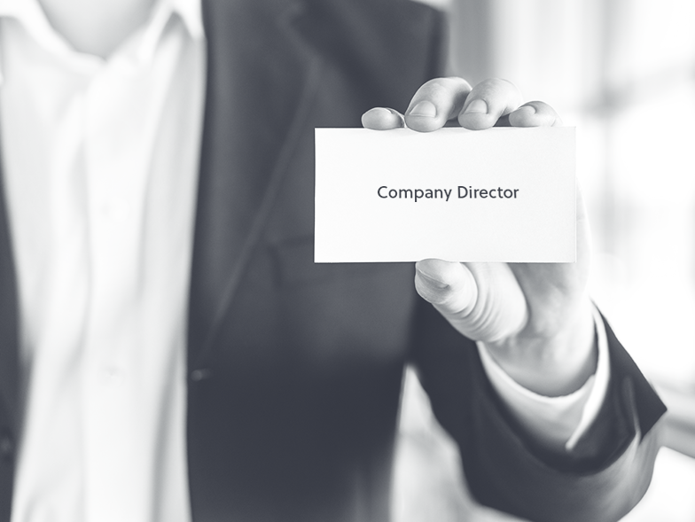 Man holding business card that says 'company director'