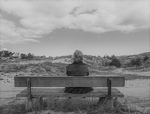 older lady sitting on bench